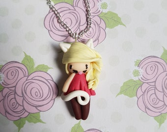 """Collier petite fille """" cheveux blond, robe rose"""" ( collection chat)"""