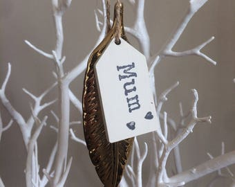 Gold Porcelain Feather with wooden handstamped tag