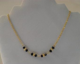 Elegant black and gold necklace