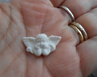 1 white Angel for hobby craft.