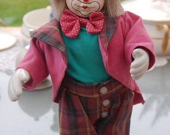 Vintage Clown figurine porcelain head,hands and feet. Wind up musical 'memories' tune
