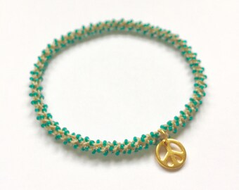 Stackable golden peace yoga charm bracelet Anahata (heart chakra)