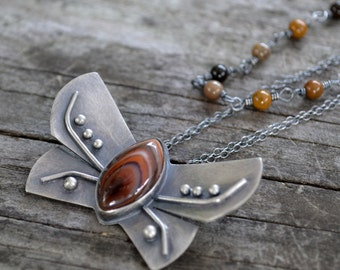 angerona prunaria (orange moth) necklace - banded agate and sterling silver