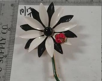 Goldtoned  black and white enamel flower signed