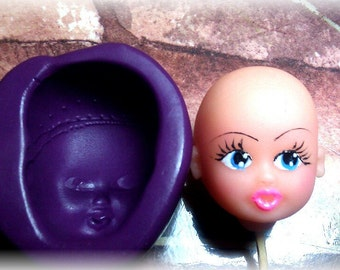 Silicone mold, with the face of a little girl.002/Molde de silicona ,la cara de una niña.