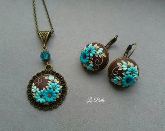 Set of earrings and a pendant of floral filigree. Earrings\clay earrings \clay pendant\clay embroidary\floral filigree\floral pendant\flower