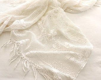 A vintage french, hand made, crocheted bedspread, cover, coverlet, blanket, in bright white cotton
