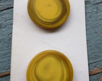 """2 Yellow """"BGE"""" plastic buttons"""