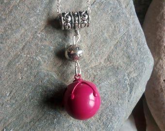 1334 - raspberry pregnancy's bola and Tibetan bead