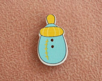 button wood yellow blue baby bottle