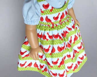 Celebrate winter and cardinals with a prairie dress and pinafore for American Girl dolls.  Blue, birds, winter