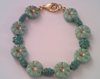 Bright cheery daisies for your wrist - in turquoise!