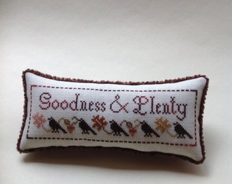 Primitive cross stitched pin cushion/ pillow/bowl filler with blackbirds by Plum Street Samplers.