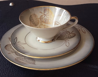 Zeh, Scherzer & Co., Bavaria, 53-178: lovely cup saucer and plate trio set from the early 1950s, gold print and pearl grey with leaves