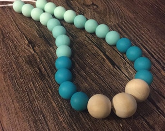 All natural wood and 100% BPA free silicone wood teething necklace