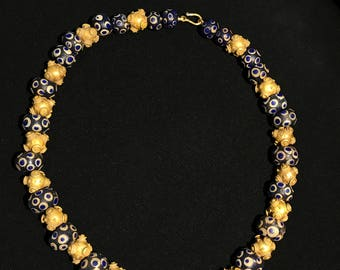 ancient roman glass with ancient gold beads