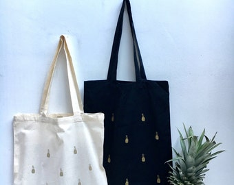 Tote bag with Golden pineapple print black or off-white 100% fairtrade labeled ecocotton