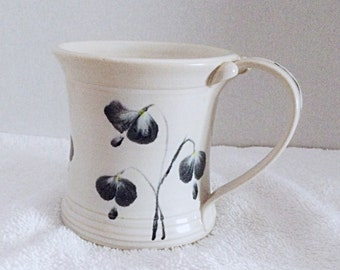 White clay, Coffee, tea, hot chocolate mug or cup, ceramic coffee cup or mug, painted with black and white flowers.