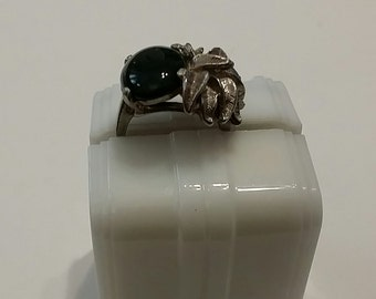 R 116 sterling silver and green stone approx size 6 1/4