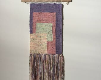 Geometric hand woven wall hanging