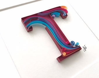 Quilled paper art monogram, letter 'T'; framed picture
