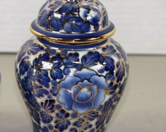 Listing 94 is an asian porcelain vase with lid