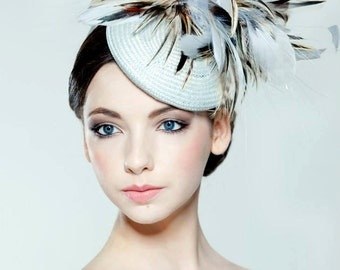 Straw percher hat with feather trim perfect for weddings/ the Melbourne Cup/Royal Ascot
