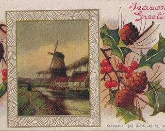 1908 Antique Postcard With Season's Greetings Message Supported by Holly Branches Pine Cones and a Framed Dutch Windmill Landscape
