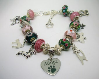 Adopt European pink & teal pink flowers Murano beads Paw prints dog and cat charm bracelet crystals You pick size Help save a cat/kitten