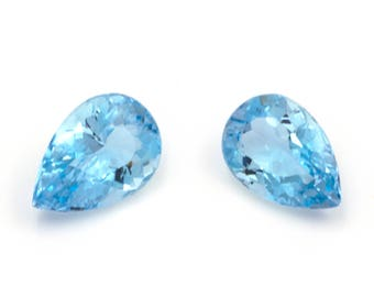 Couple of natural aquamarines, pear-cut,  weight: 2.15 ct.