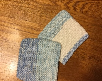 Pair of hand knit cotton coasters
