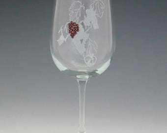 "Grapes Red Wine Glass - Permanently frosted grapevine design with burgundy Swarovski crystal ""grapes""."