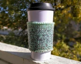 Knit coffee cozy sleeve in seafoam
