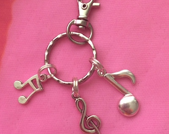 FREE SHIPPING in USA!!  Amazing Music Key Fob/Purse Charm on Silver Toned Hardware