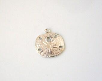 sanddollar charm cast in sterling silver .925 or tarnish resistant argentium sterling silver .935