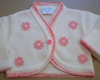 baby girl bolero with  varigated pink  crochet around  front and sleeve cuffs,