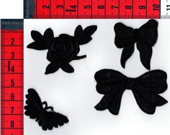 4 small black patches (bows, butterfly, Star and pink) mixed seconds or sew on Patch applique