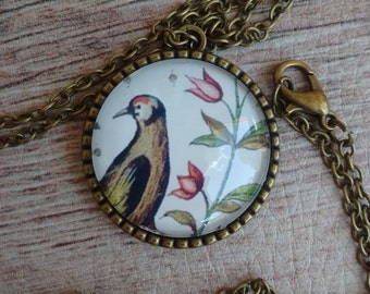 Pendant with bird and flowers