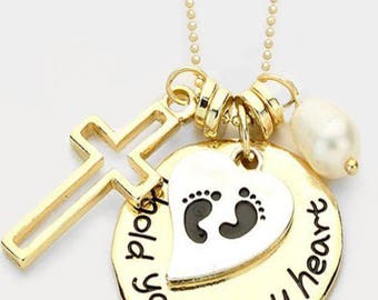 Hold you in my heart the inspired gold necklace