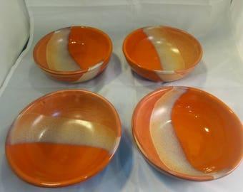 Set of four pottery ceramic bowls