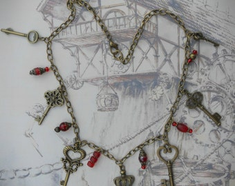 The Gatekeeper necklace, steampunk key necklace, antique bronze, red pressed glass bead charms, whimsical necklace, quirky necklace