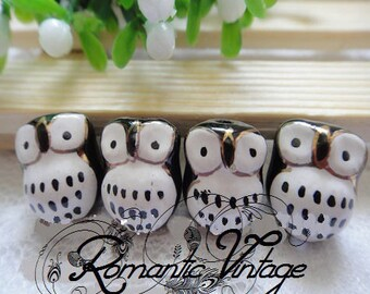 2 pretty beads, black and decorative OWL pendants gold 16 * 14mm