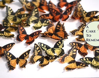 "24 autumn wedding cake topper yellow and orange edible butterflies. 1.5"" across, vegan wafer paper butterflies for cupcake decorating."