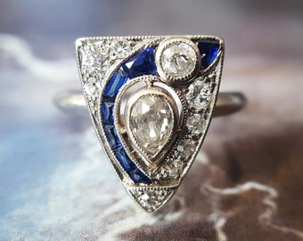 Art Deco Engagement Ring | Vintage Engagement Ring | Diamond Engagement Ring: Art Deco Pear Cut Diamond Ring with Sapphires in Platinum