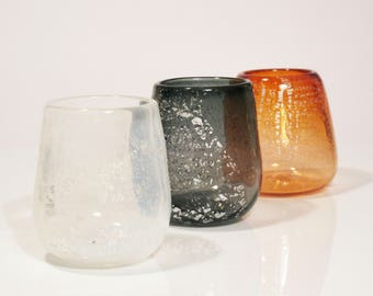 Kosetsu blown glass candle holder with silver leaf pattern.