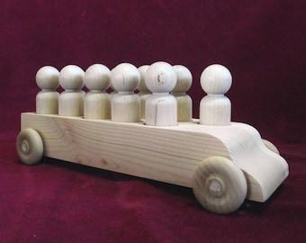 Unfinished Pine Bus #5 with 11 Hardwood Lg. Boy Peg Dolls