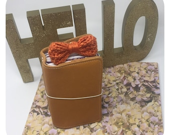 Orange Crochet Bow attached to a Large Paper Clip