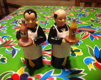 Vintage ceramic hand painted pair of waiters carrying wine bottles salt and pepper shakers