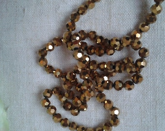 set of 10 Golden faceted glass beads