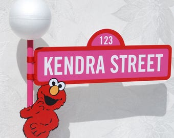 Sesame Street Sign with Lamp Post and Elmo character in Pink and Red for Girl